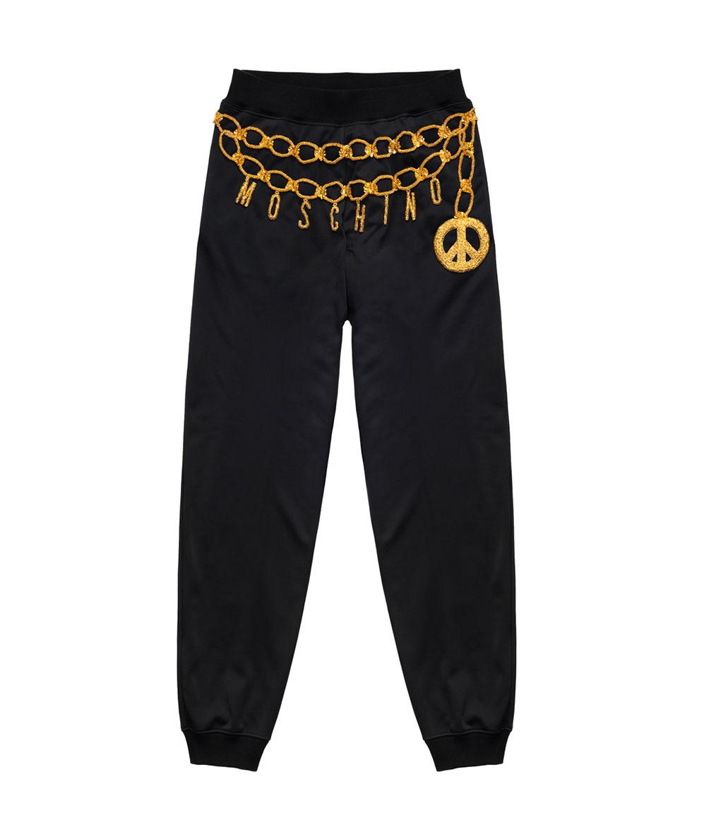 Svarta byxor med guldbrodyr från H&M x Moschino