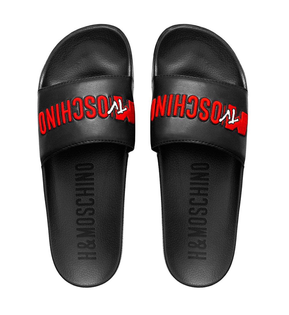Svarta tofflor med röd text Moschino x H&M